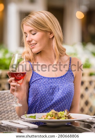 Beautiful woman sitting in the restaurant and enjoying the meal. - stock photo