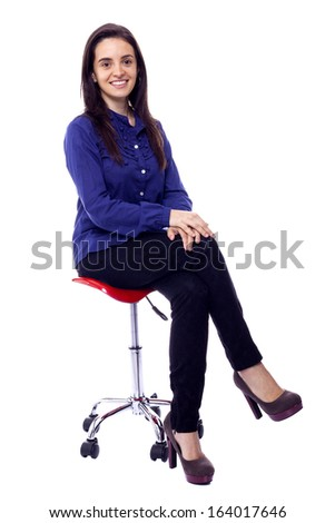 Beautiful woman sitting on chair, isolated on white  - stock photo