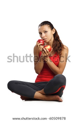 beautiful woman sitting on floor with red apples isolated in white - stock photo