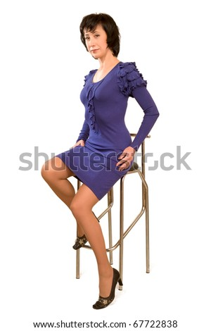 Beautiful woman sitting on the bar chair