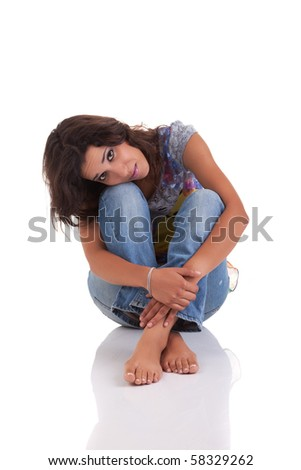 beautiful woman, sitting on the floor, isolated on white background - stock photo