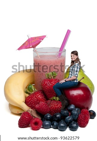 Beautiful woman sitting with a delicious cold Fruit Smoothie or daiquiri and fruit - stock photo