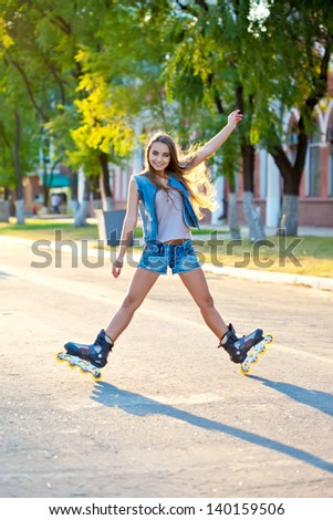 beautiful woman skating outdoors  during sunset