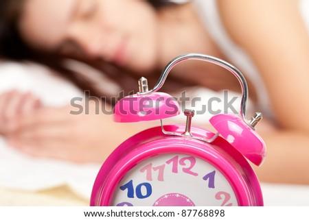 beautiful woman sleeping and alarm clock - stock photo