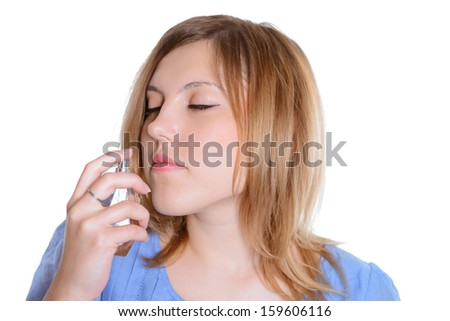 beautiful woman smelling perfume