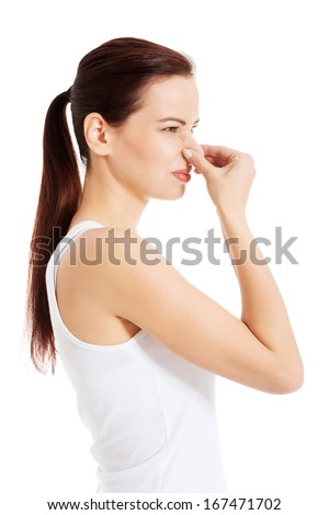 Beautiful woman smells bad scent. Isolated on white.  - stock photo