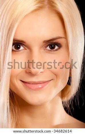 Beautiful woman smiles. - stock photo