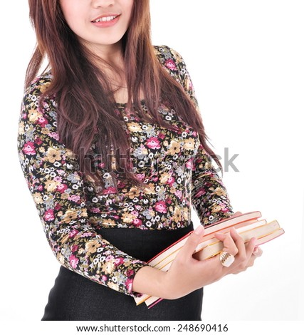 beautiful woman smiling and carrying books, isolated on white background - stock photo