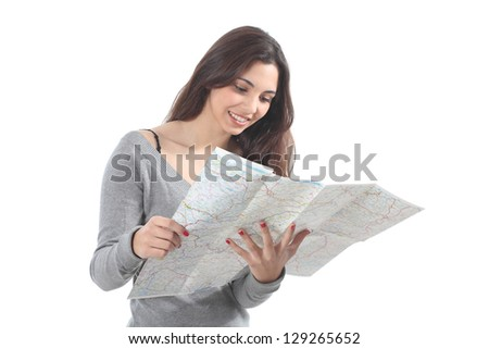 Beautiful woman smiling and watching a road map on a white isolated background - stock photo