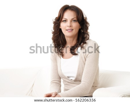 Beautiful woman smiling on the sofa. White Background - stock photo