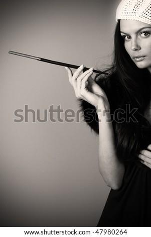 Beautiful  woman smoking. Retro portrait. Sepia toned. - stock photo