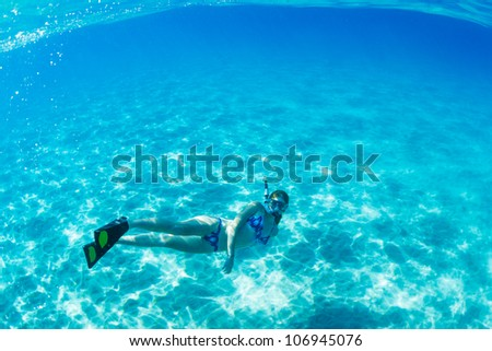 Beautiful Woman Snorkeling in Tropical Ocean