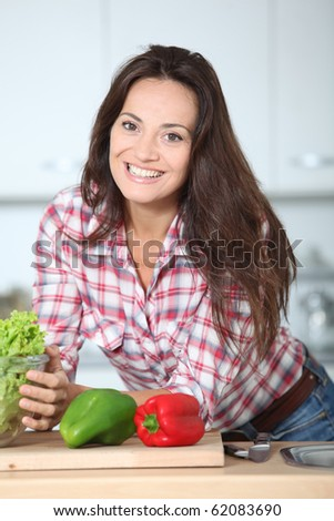 Beautiful woman stading in kitchen