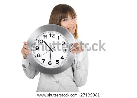 Beautiful woman standing over a white background holding a clock