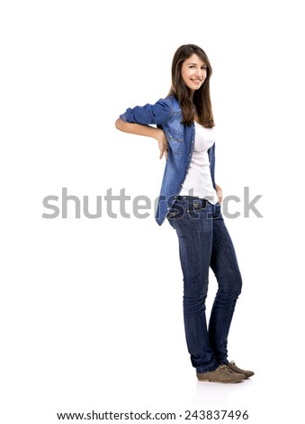 Beautiful woman standing over a white background with copyspace for the designer