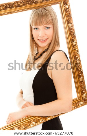 Beautiful woman standing with frame,  smiling and looking to the camera - stock photo