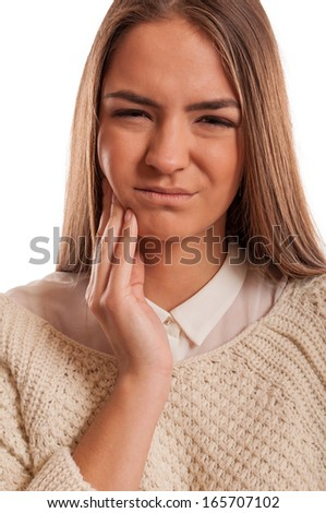 Beautiful woman suffering from toothache isolated on white - stock photo