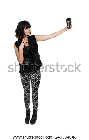 Beautiful woman taking a selfie with a cell phone - stock photo