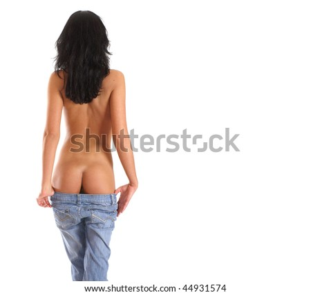 Beautiful woman taking off jeans isolated on white - stock photo