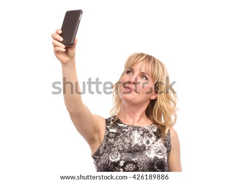 Beautiful woman taking self picture with smartphone camera. Isolated on white. - stock photo
