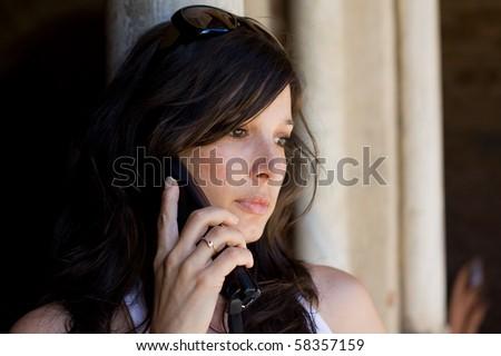 Beautiful woman talking on cell phone - stock photo