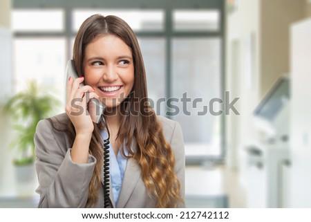 Beautiful woman talking on the phone - stock photo