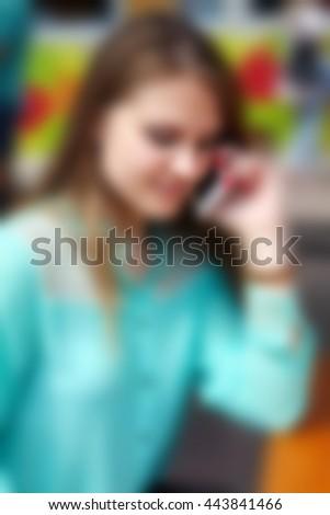 Beautiful woman talking on the phone. Fuzzy photo. Blur - stock photo