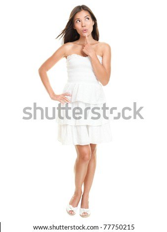 Beautiful woman thinking happy looking up wearing white summer dress.. Sexy gorgeous multiracial Asian / Caucasian female model isolated on white background in full figure. - stock photo