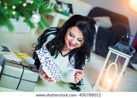Beautiful Woman under the Christmas tree