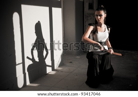 Beautiful Woman Unsheating Sword With Shadow Showing Her Figure