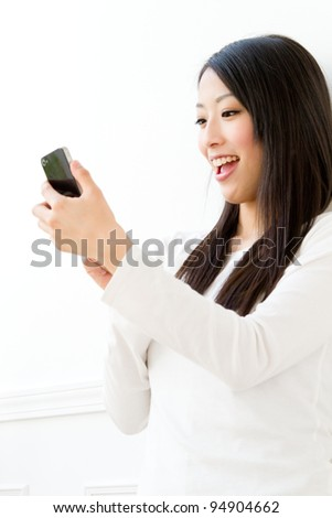 Beautiful woman using a mobile phone. Portrait of asian woman.