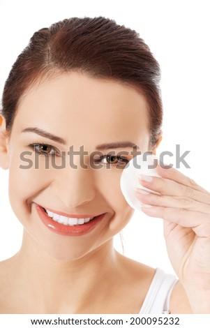 Beautiful woman using cotton pad - stock photo