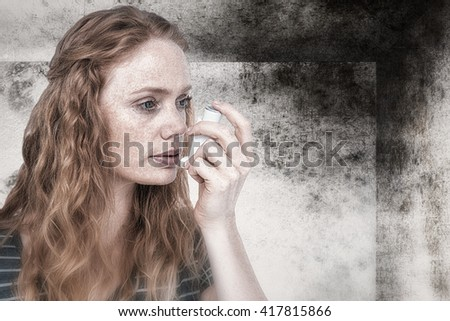 Beautiful woman using the asthma inhaler against image of room corner - stock photo