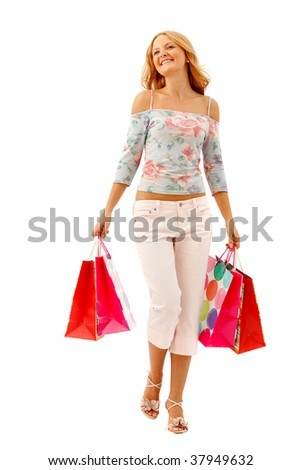 Beautiful woman walking with shopping bags isolated - stock photo