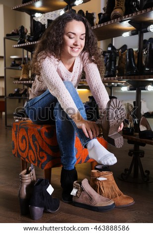 Beautiful woman wants to buy the shoes