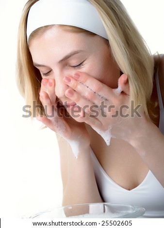 Beautiful woman washing her face - stock photo