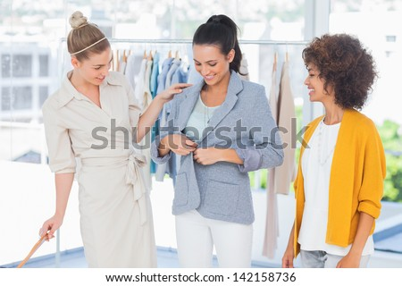 Beautiful woman wearing a blazer in a creative office - stock photo