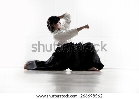 beautiful woman wearing a hakama engaged in Aikido