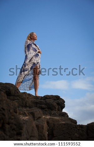 Beautiful Woman wearing a Kimono on a Bluff