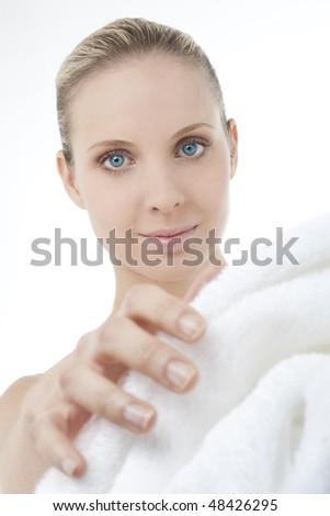 Beautiful woman wearing bathrobe, focus on the model - stock photo