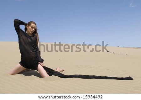 beautiful woman wearing black clothes in the desert