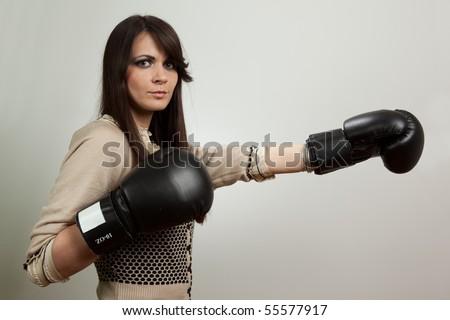 Beautiful woman wearing boxing gloves - stock photo
