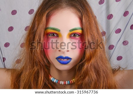 Beautiful Woman Wearing Colorful and Bright Makeup - stock photo