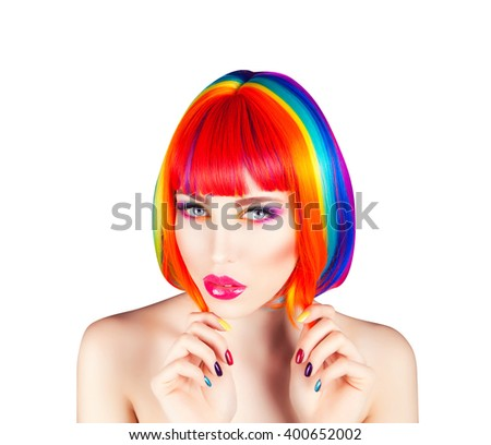 beautiful woman wearing colorful wig and showing colorful nails against dot background