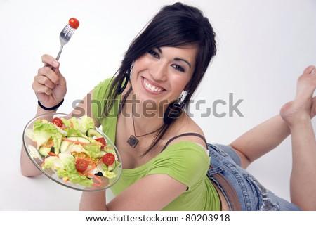 Beautiful Woman Wearing Green Eating Fresh Tossed Lettuce Salad - stock photo