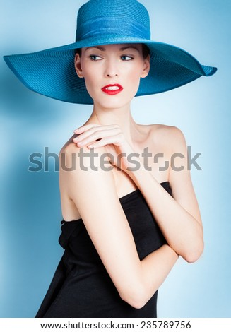 Beautiful woman wearing hat. Studio fashion portrait. - stock photo