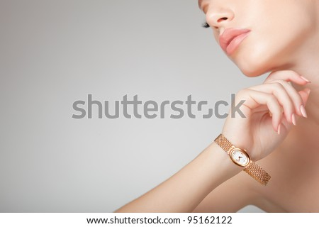 beautiful woman wearing jewelry, very clean image with copy space - stock photo