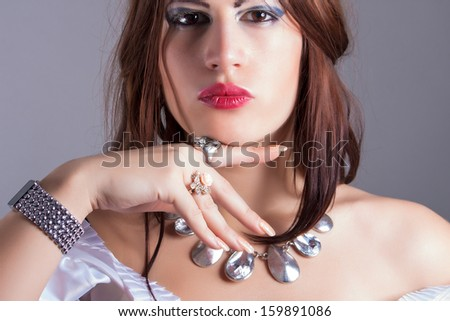 beautiful woman wearing necklace and rings - stock photo