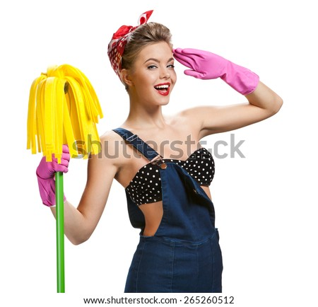 Beautiful woman wearing pink rubber protective gloves holding cleaning mop / young beautiful American pin-up girl isolated on white background. Cleaning service concept - stock photo