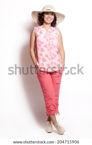 beautiful woman wearing pink summer outfit on white background